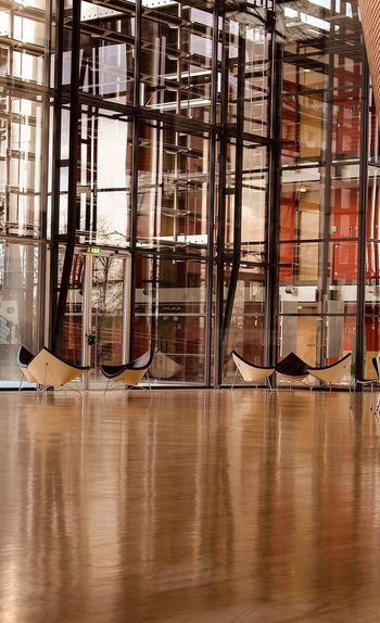 Reflection of window on hardwood floor in building