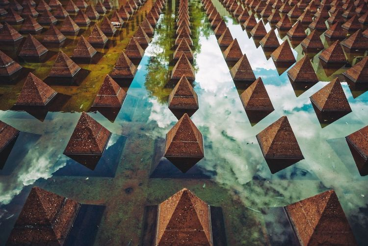 High angle view of pyramids in pond