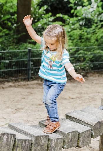 Full length of girl standing on footbridge