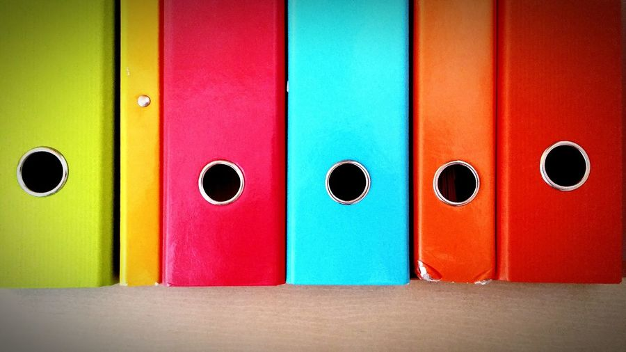 Close-up of colorful ring binders