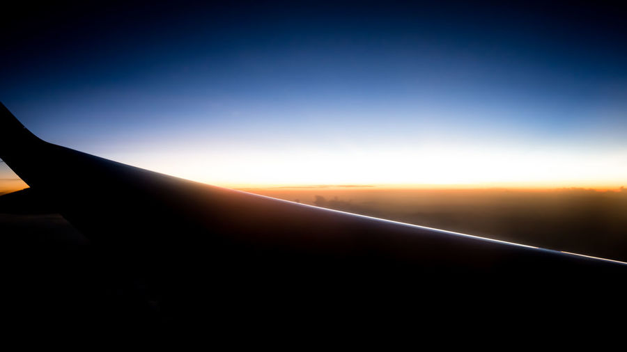 Sunrise on the Flight Airplane Airplane View Airplane Wing Beauty In Nature Clear Sky Day Nature Outdoors People Sky Sun Sunrise Transportation Traveling Home For The Holidays Finding New Frontiers