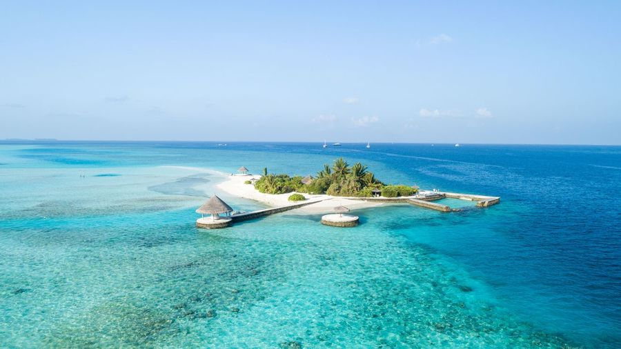 Small island Maldives Sea Water Beauty In Nature Scenics - Nature Horizon Over Water Sky Nautical Vessel Horizon Tranquility Blue Nature Outdoors Travel Day Beach Tranquil Scene Transportation Land Idyllic Waterfront