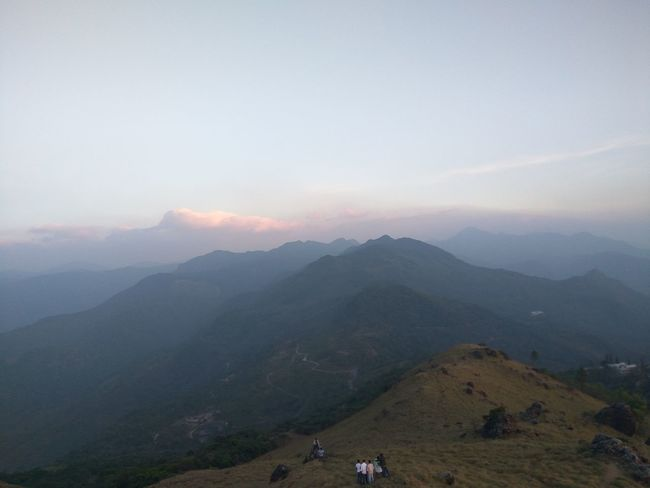 Mountain Tourism Outdoors Mountain Peak Scenics No People Astronomy Nature Mountain Range Sky Landscape Beauty In Nature Vacations Fog Night Ponmudihills Travel Environmental Conservation Vacations Hills, Mountains, Sky, Clouds, Sun, River, Limpid, Blue, Earth First Eyeem Photo India Kerala