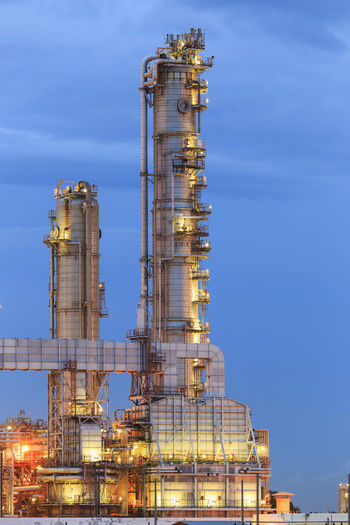 Architecture Blue Building Exterior Built Structure Business Chemical Plant Dusk Factory Fuel And Power Generation Illuminated Industrial Building  Industrial Equipment Industry Low Angle View Nature No People Oil Industry Outdoors Refinery Sky Smoke Stack Tall - High