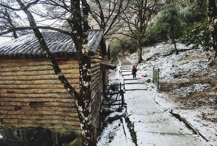 People walking on footpath during winter