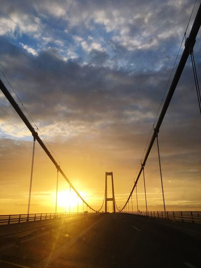 Large bridge in the sunset Direction Way Beautiful Transport Sunrise Sunset Architecture Bridge Sky Sunset Cloud - Sky Nature No People Sunlight Beauty In Nature Scenics - Nature Silhouette Orange Color Sun Environment Outdoors Tranquility Field Fence Barrier Landscape Tranquil Scene Land