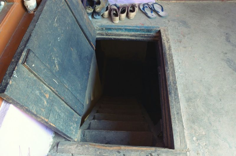 'The original chamber of secrets. ' A door going down into the winter adobe. Things Shoes Door Floor Stairs Downstairs Rural Country Country Life Door On The Floor Pangi Life Of Pangwals Himalayas Winter Home Tribal Life My Favorite Photo Kotha Original Experiences