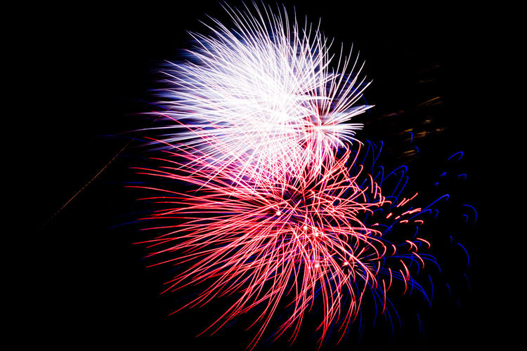 Fireworks on black night sky. Firework Display Photos. Black Background Exploding Firework - Man Made Object Firework Display Glowing Illuminated Multi Colored Night No People Outdoors Sparks