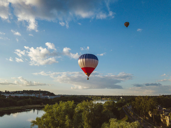Hot air balloons DJI Mavic Pro DJI X Eyeem Drone  Hot Air Balloons Lietuva Adventure Aerial Air Vehicle Balloon Ballooning Festival Beauty In Nature Cloud - Sky Day Drone Photography Environment Europe Flying Hot Air Balloon Landscape Mavic Mavic Pro Mid-air Mode Of Transportation Mountain Nature No People Outdoors Scenics - Nature Sky Summer Transportation Travel Tree Water The Great Outdoors - 2018 EyeEm Awards