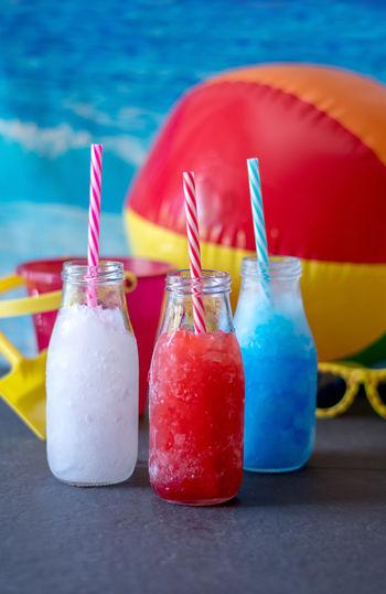 Lemonade slush, blueberry slush and strawberry slush. patriotic cool drinks for your 4th of july