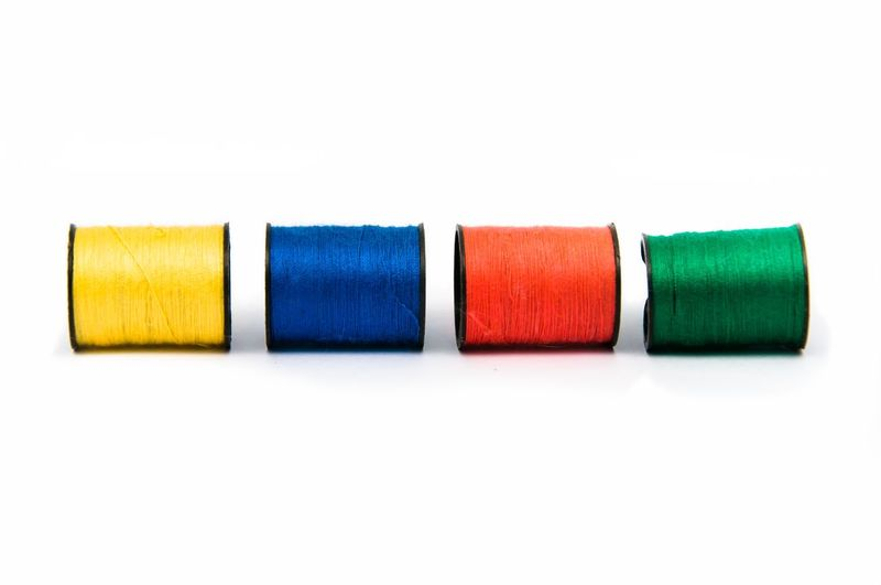 Close-Up Of Colorful Thread Spools
