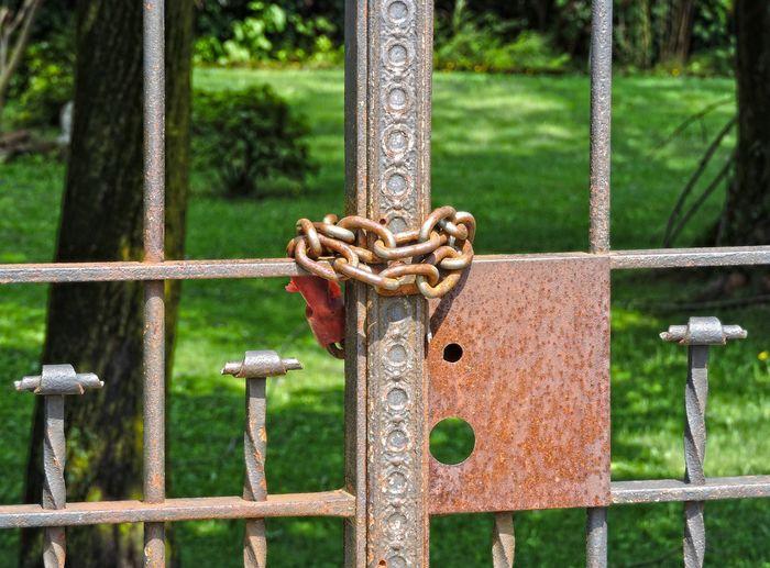 Close-up of padlock on metal railing