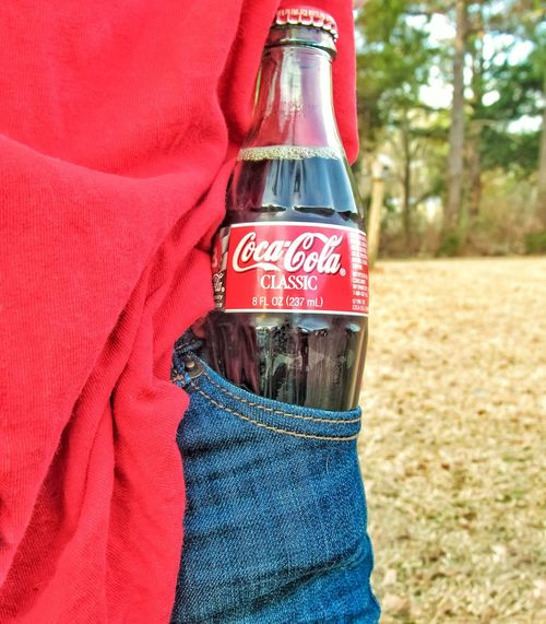 one for the road Red Casual Clothing Outdoors Drink Coke Coke Bottle Bottle Cocacola Blue Jeans Jeans Pocket  Thristy Beverage Small Lazy Drink Pants Pocket Front View From My Point Of View Side View Text Brand Text Communication Red No People Day Close-up Outdoors