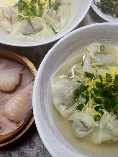 High Angle View Of Fresh Dumplings In Bowls On Table