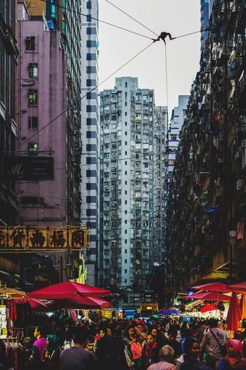 Reframinghk Street Photography Discoverhongkong Architecture City Built Structure Building Exterior Crowd Group Of People Building City Life Office Building Exterior Sky Street Illuminated Large Group Of People Real People Nature Tall - High Residential District City Street Crowded Office