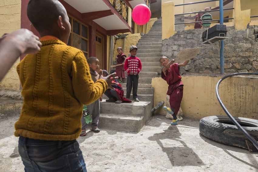 School kids playing cricket at Dhankar, Spiti Valley Children Dhankar Dhankar Monastery India Kids Travel Adult Architecture Ball Building Exterior Children Only Cricket Day Himachal Outdoors People Playing Real People School Shadow Spiti Standing