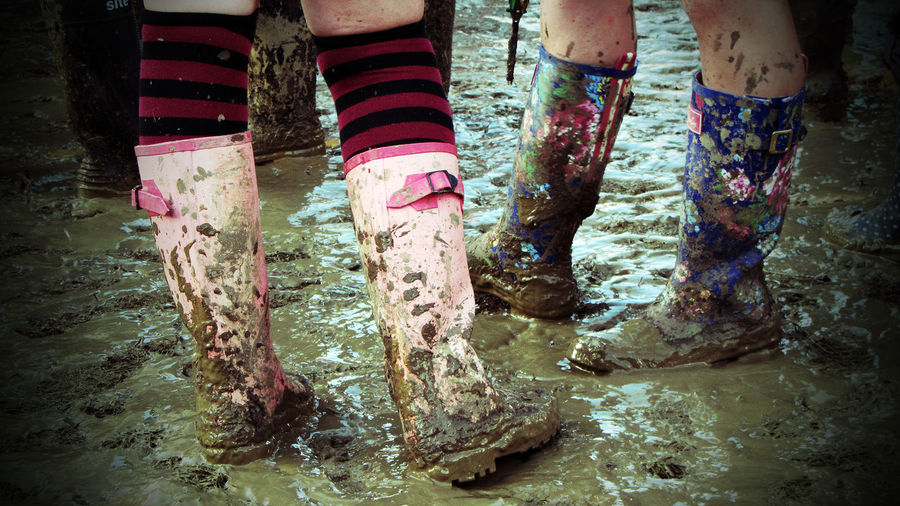 Adult Adults Only Close-up Day Glastonbury Glastonbury Festival Human Leg Low Section Mud Muddy Music Outdoors People Puddle Real People Standing Water Wellies  Wet