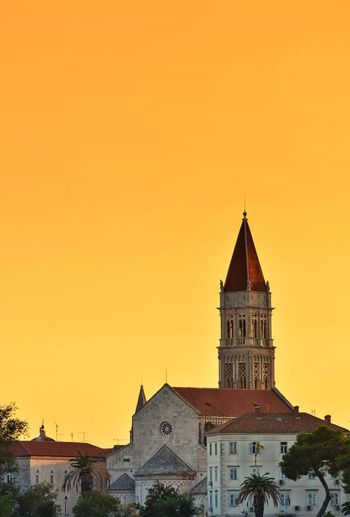 Church against clear orange sky during sunset