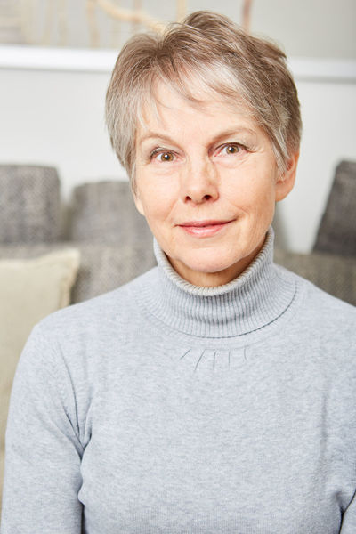Adult Adults Only Blond Hair Casual Clothing Close-up Confidence  Day Focus On Foreground Indoors  Living Room Looking At Camera Mature Adult One Person People Portrait Senior Senior Adult Senior Woman Smiling Sofa