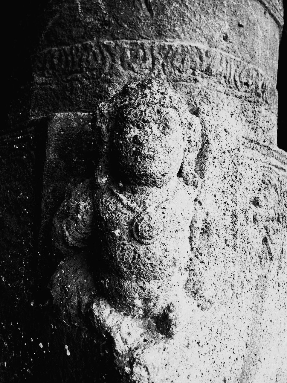 CLOSE-UP OF STATUE ON WALL