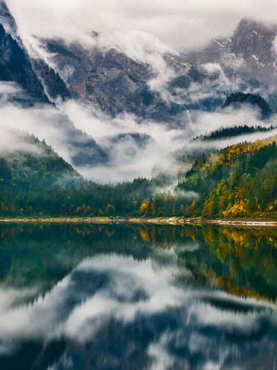 Nature Nature Photography Beauty In Nature In The Woods Trees Autumn colors Autumn Leaves Clouds And Sky Austrian Alps Dachstein Gosausee Reflections In The Water Tranquility Water Mountain Wilderness Area Sunset Tree Forest Lake Autumn Fog Backgrounds Dramatic Landscape Reflection Lake