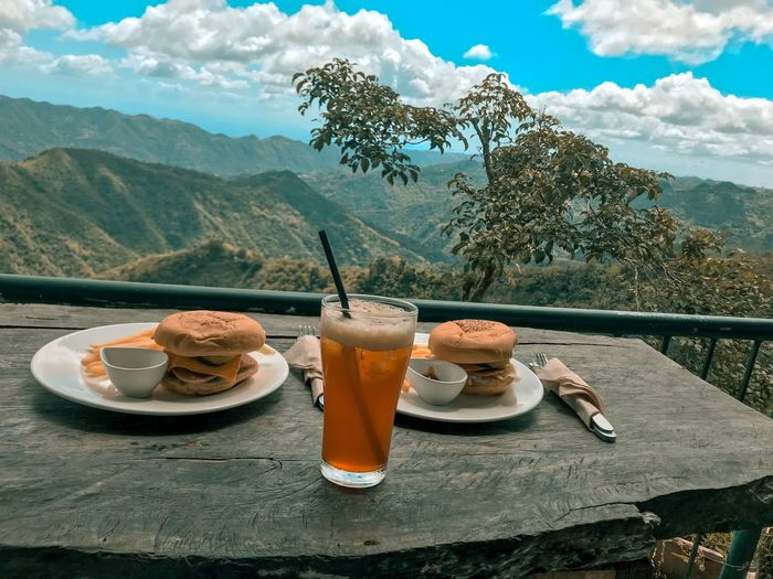 Breakfast on table against mountains