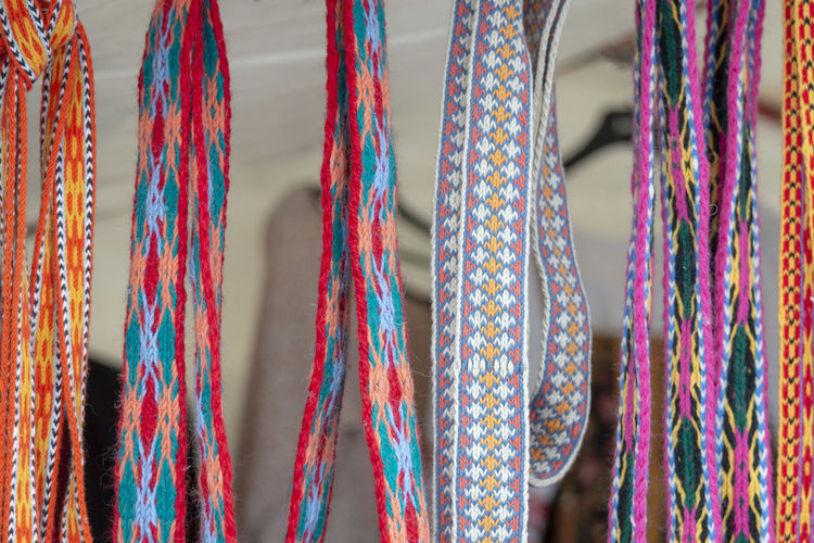 Close-up shot of laces hanging in store