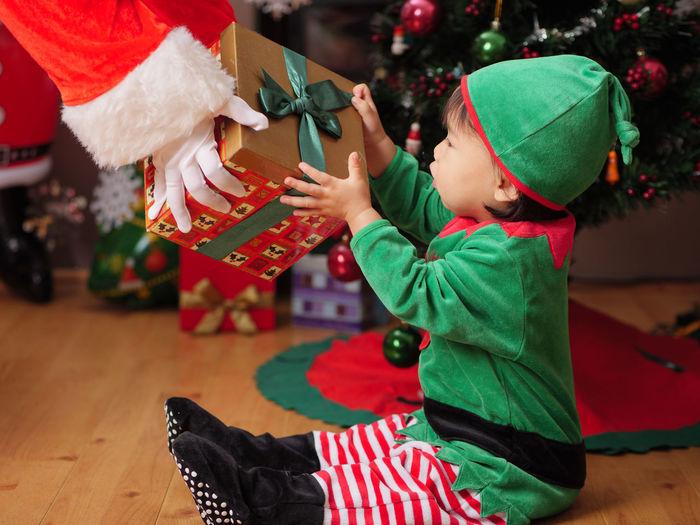 Boy holding christmas tree