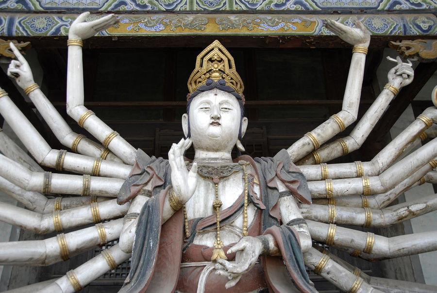 Architecture Art And Craft Boddhisattva Buddhism China Creativity Day Guanyin Human Representation Low Angle View No People Outdoors Religion Sculpture Spirituality Statue