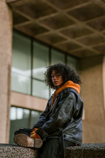 Nandy Harris, London 2018 Street Portrait Women Of EyeEm Portrait Of A Woman Architecture And People International Women's Day 2019 One Person Real People Focus On Foreground Clothing Curly Hair Three Quarter Length Leisure Activity Women Side View Hairstyle