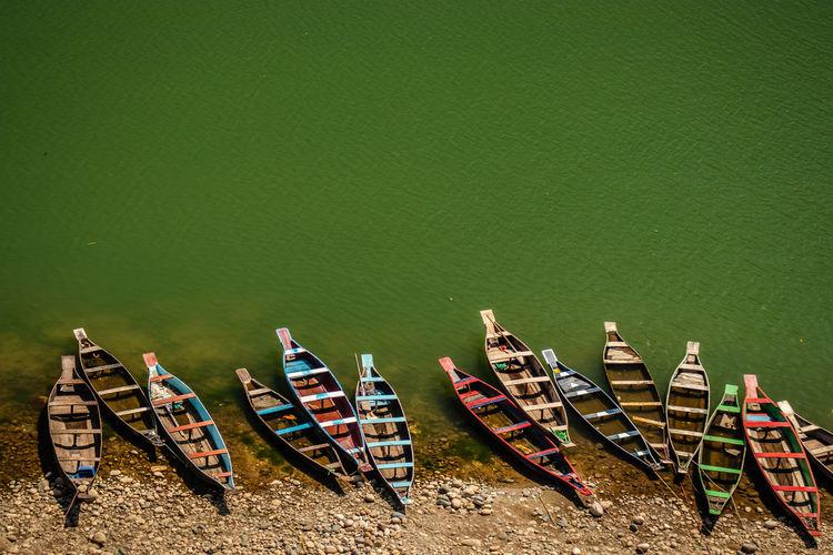 Fishing boat many at river shore at morning from flat angle
