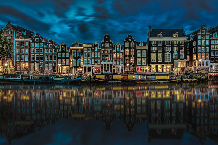Amsterdam Apartment Architecture Blue Building Exterior Building Story Built Structure Canal City City Life Harbor In Front Of No People Reflection Reflection Lake Residential Building Residential District Residential Structure River Singel Sky Travel Destinations Water Waterfront