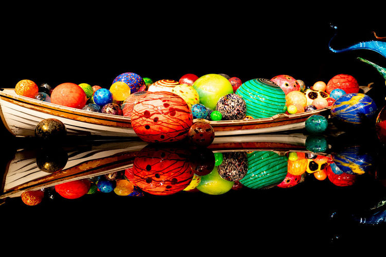 High angle view of multi colored candies against black background