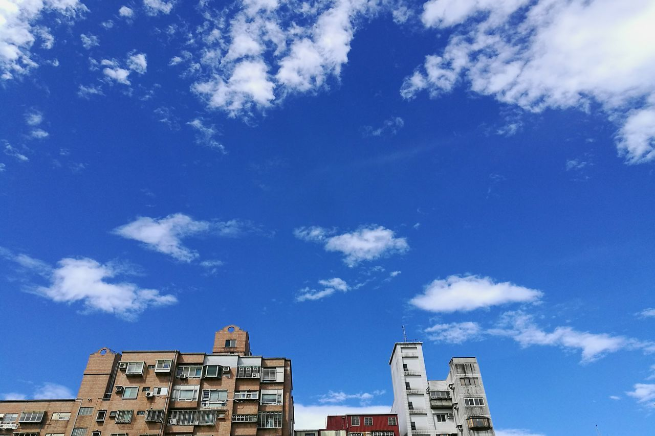 building exterior, architecture, built structure, low angle view, sky, blue, cloud - sky, text, day, outdoors, no people, city