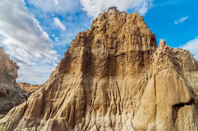 Low angle view of rock formation at tatacoa desert against sky