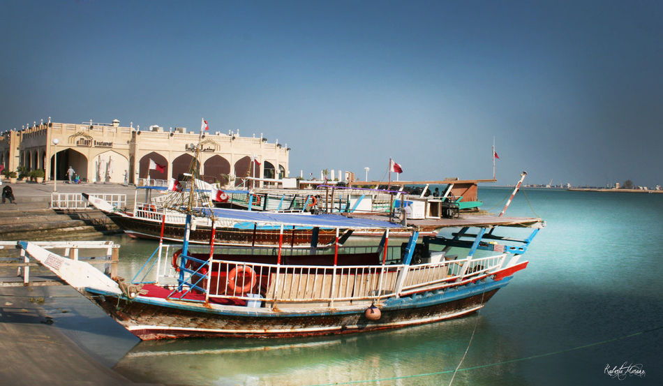 Architecture Blue Blue Sky Boat Building Exterior Built Structure Clear Sky Colors Commercial Dock Corniche Dhow Dhow Boat Dhowcruise Doha Harbor Mode Of Transport Moored Nautical Vessel No People Sea Tranquility Transportation Water Waterfront