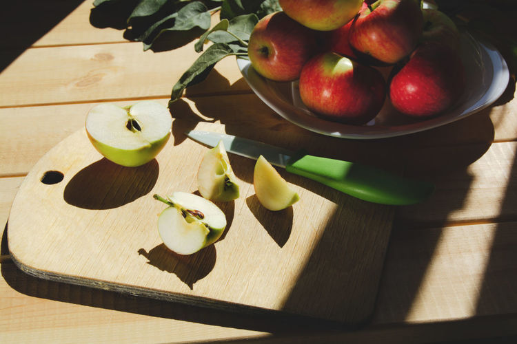 The process of making a homemade apple drink. delicious, fresh and healthy fruits