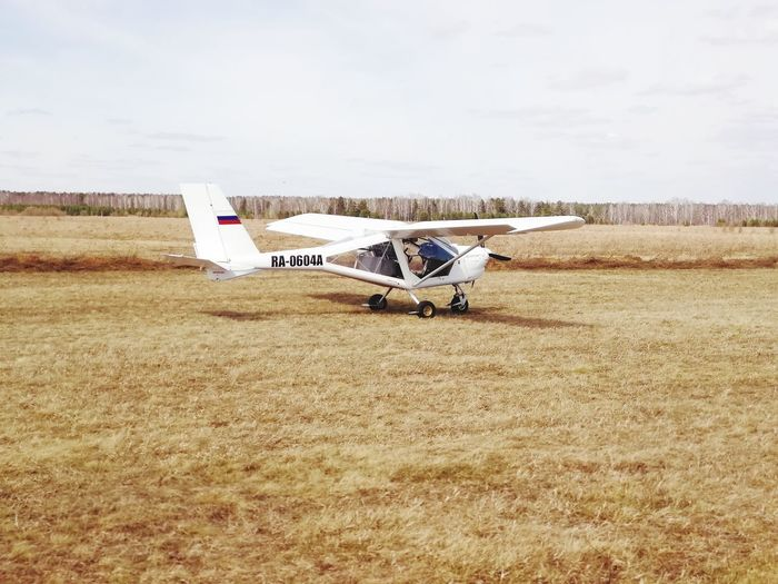 A small plane Fly Plane Rural Scene Agriculture Sky