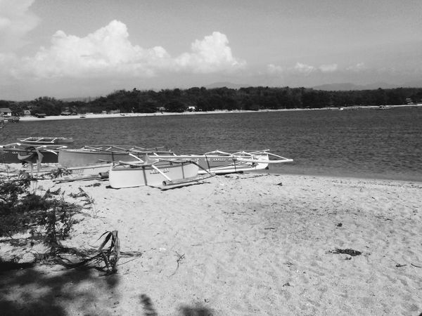 Beach Sand Water Outdoors Tranquility Pedal Boat Nature Sea Day No People Sky Tree Moored Nautical Vessel Scenics Albay,Philippines Beauty In Nature Blackandwhitephotography Landscape Dramatic Sky Travel Destinations Horizon Over Water Offshore Platform