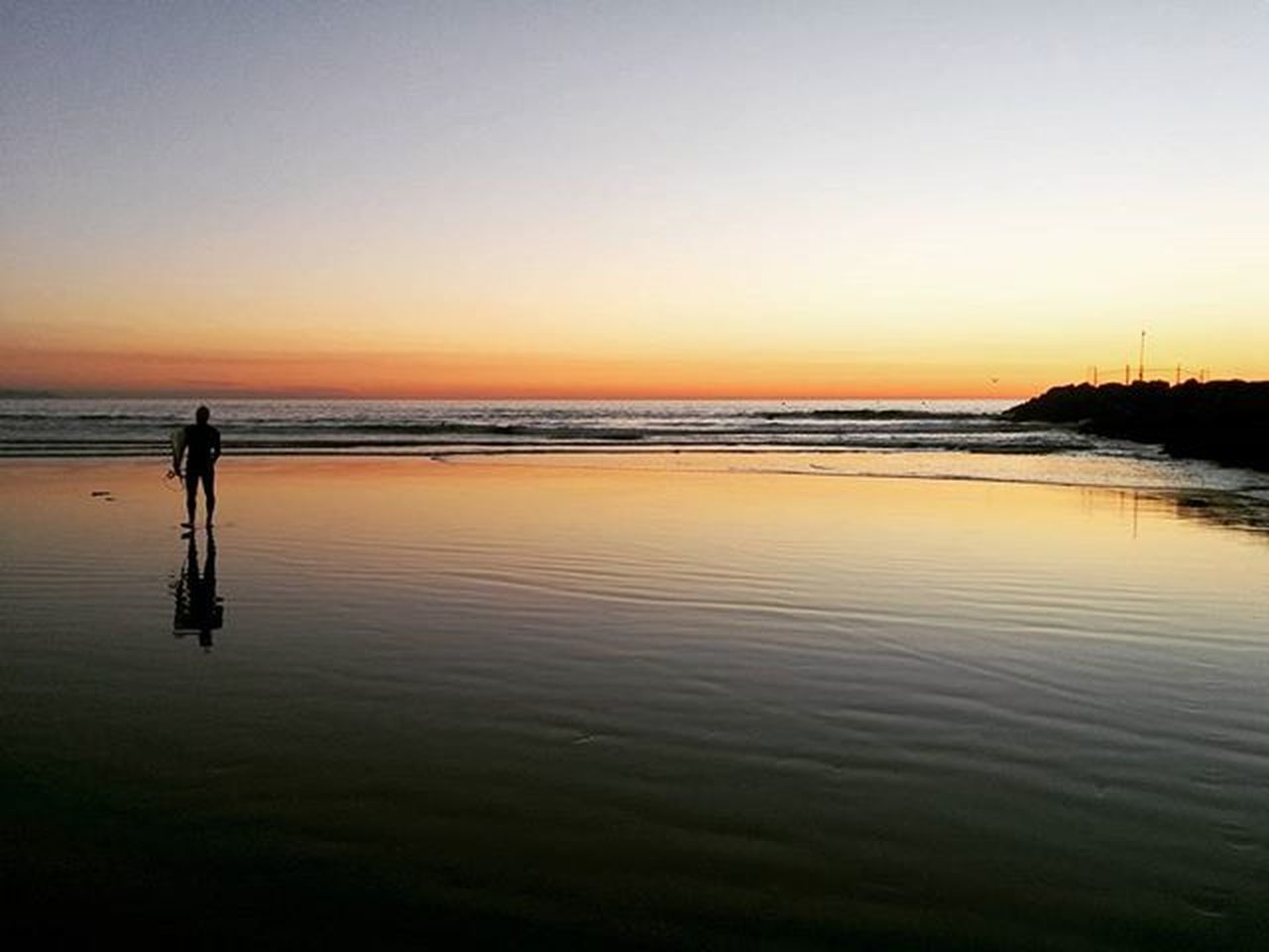 beach, sunset, water, sea, nature, reflection, scenics, tranquility, beauty in nature, silhouette, tranquil scene, sky, outdoors, full length, vacations, sand, horizon over water, one person, clear sky, people, one man only, adult, adults only, day