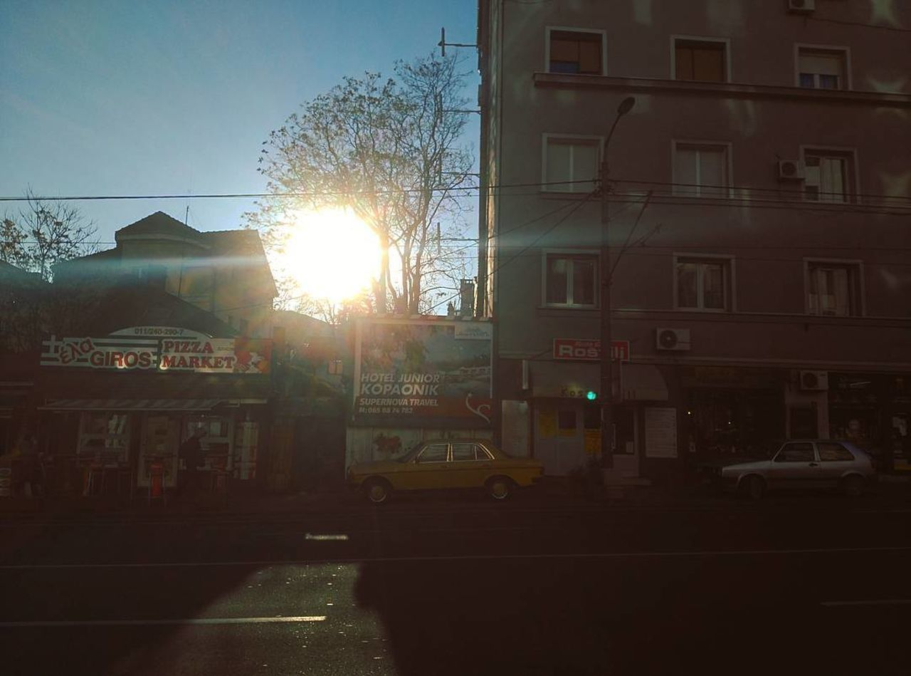 architecture, building exterior, built structure, sunlight, street, lens flare, outdoors, no people, sun, house, transportation, residential building, land vehicle, road, day, city, sky, tree