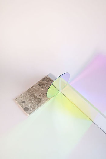High angle view of paper on table against white background