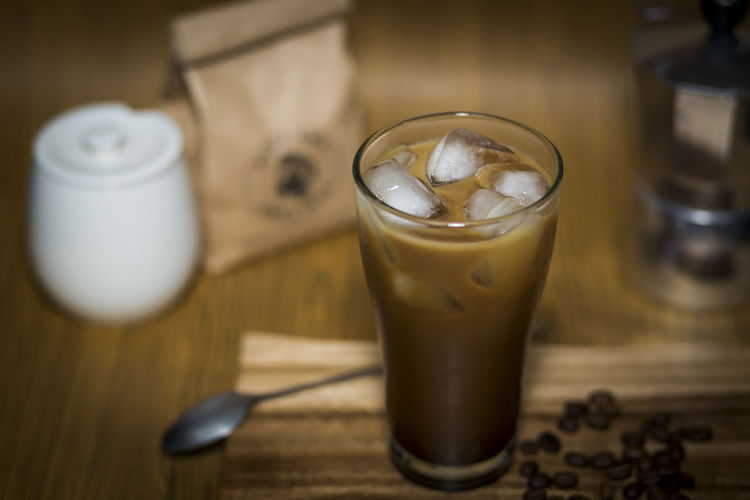 Close-Up Of Iced Coffee On Cutting Board