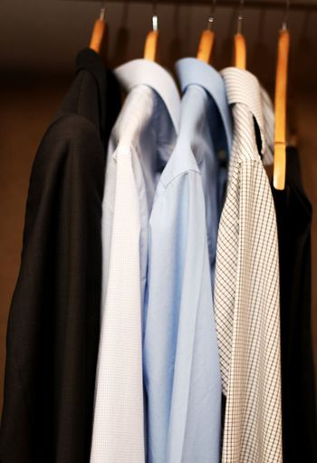 Close-Up Of Shirts Hanging In Wardrobe