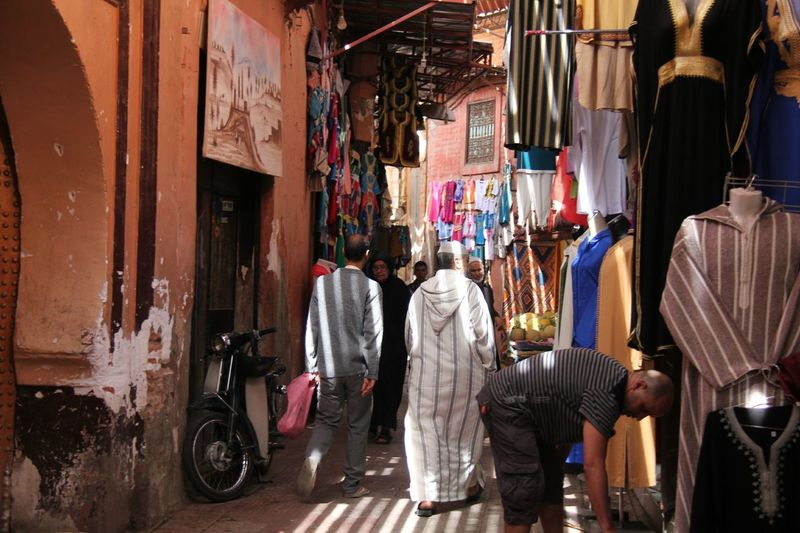 Adult Bazar Day EyeEm Selects Fashion Indoors  Lifestyles Market Marrakech Marrakech Medina, Morocco Men Morocco Morocco Travel People Real People Rear View Retail  Standing Store Suq Two People Women