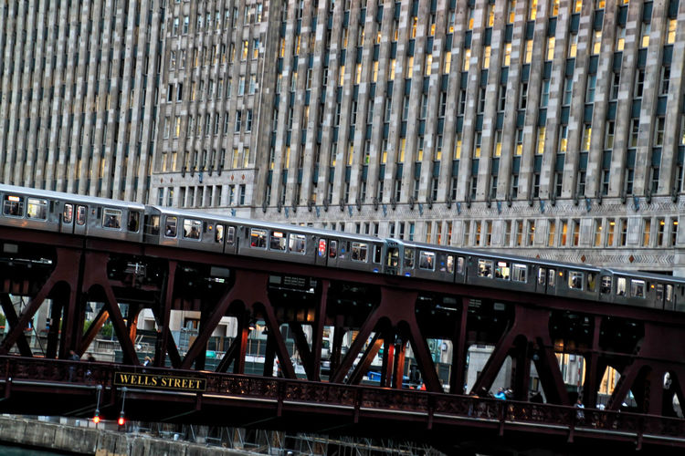 Moving elevated train in the downtown Loop of the City of Chicago Chicago River Chicago El Chicago Loop Cityscape Downtown Chicago Elevated Track Transit Architecture Bridge - Man Made Structure Built Structure City City Of Chicago Connection Day Elevated Train Indoors  Mode Of Transport Modern No People Public Transportation Rail Transportation Railroad Track Train - Vehicle Transportation Urban