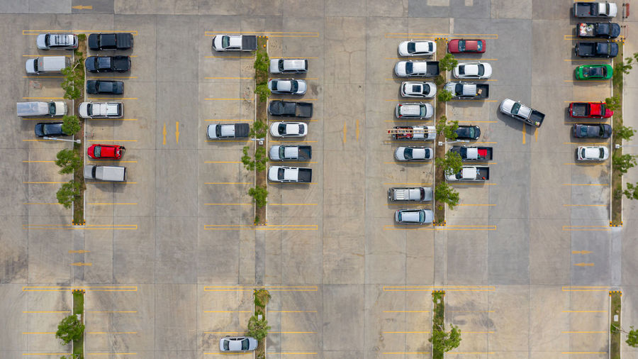 Aerial view of cars parked on street in city