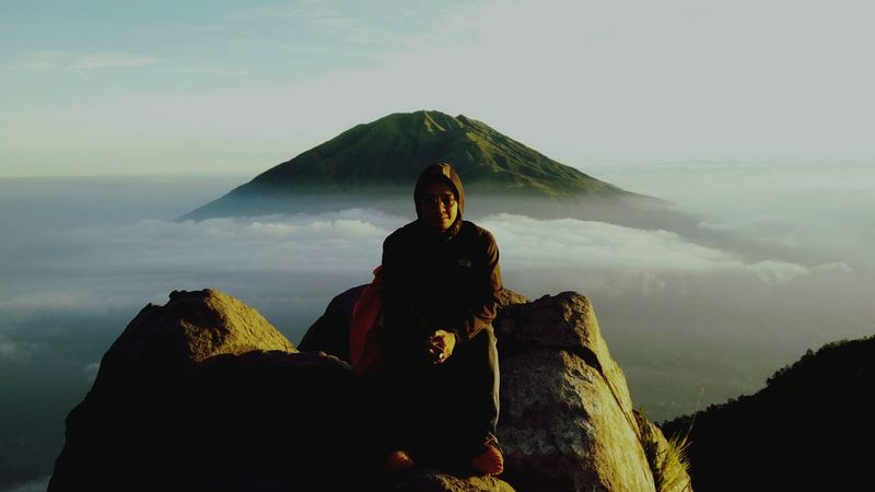 Two-Face!!! Merapi Volcano Merapimountain Merapi Mount Merapi In The Morning Sitting People One Person Spirituality Landscape Outdoors One Man Only Nature Day Sky Mountain Outdoors Photograpghy  Nature Photography Outdoors Photograpghy  Nature Mountain Hiking Visitjogja Visitindonesia Jogja Jogjakarta Jogjaistimewa