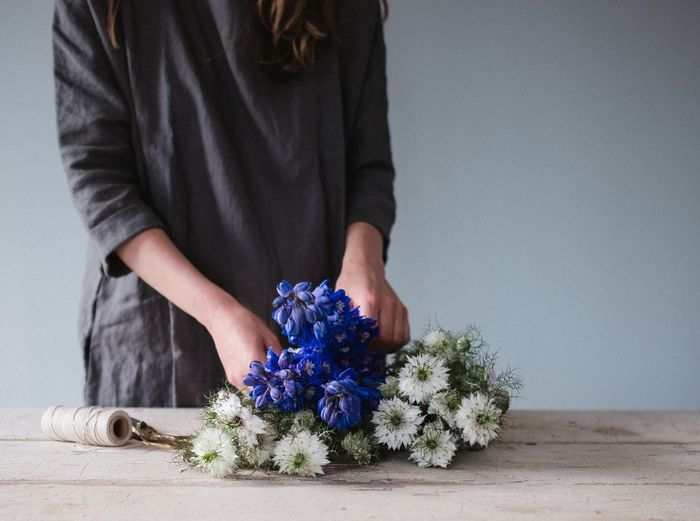 Makers Woman Summer Flowers Dress Hands Linen Flower Head Freshness Florist Floral Focus On Foreground Sommergefühle Flower Arrangement The Week On Eyem Flower Still Life Photography EyeEm Selects Weekend Activities One Person Indoors  Bouquet Real People