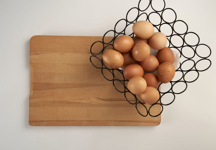 High angle view of eggs on cutting board